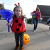 Two-year-old Charlotte Griffith of Effingham carries her Halloween parade bounty home.<br /> Chet Piotrowski Jr. photo/Piotrowski Studios