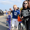 Six-year-old Ian Kinkelaar accompanied by his cousins Kloey Bierman, 5 (left) and Jersey, 9 (right) watch the Halloween parade participants travel down Jefferson Avenue Sunday afternoon.<br /> Chet Piotrowski Jr. photo/Piotrowski Studios