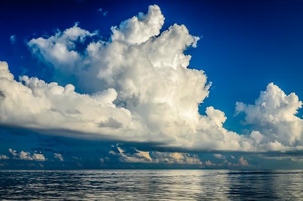 Cumulus Clouds - Calm Seas