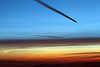 Two aircraft contrails at sunset