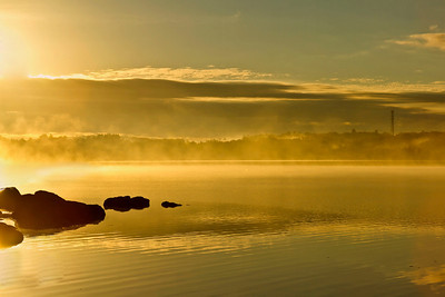 Loves Embrace: Smoke on the water at sunrise creates a warm yellow glow embracing us with love