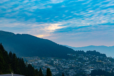 Panorama Sunrise over the Southern Alps,  Kā Tiritiri o te Moana, on lake Wakatipu, Queenstown New Zealand. Beautiful sky colors over the hillside houses of Queenstown. .