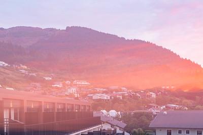 Sunrise over the Southern Alps, Kā Tiritiri o te Moana, and lake wakatipu, Queenstown New Zealand. Intense Flare on the mountains.