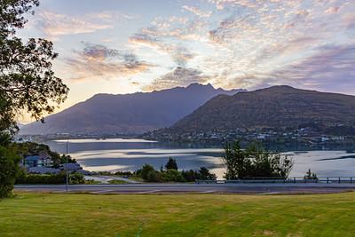 Sunrise over the Southern Alps  Kā Tiritiri o te Moana on Frankton arm, Queenstown, New Zealand.