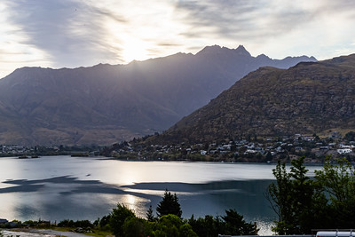 Sunrise over the Southern Alps, Kā Tiritiri o te Moana, at Frankton Arm, Queenstown New Zealand.