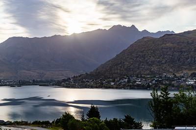 Sunrise over the Southern Alps, Kā Tiritiri o te Moana, at Frankton Arm, Queenstown New Zealand.