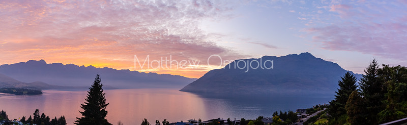 Sunrise over the Southern Alps, Kā Tiritiri o te Moana, and lake wakatipu, Queenstown New Zealand.