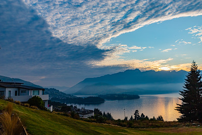 Sunrise over the Southern Alps  Kā Tiritiri o te Moana on lake wakatipu, Queenstown, New Zealand.