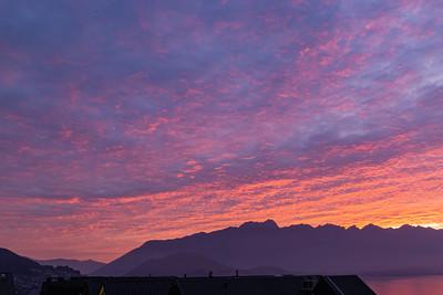 Just before Sunrise over the Southern Alps, Kā Tiritiri o te Moana, and lake wakatipu, Queenstown New Zealand.