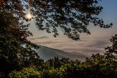 sunrise over foggy hills, mt. pisgah region