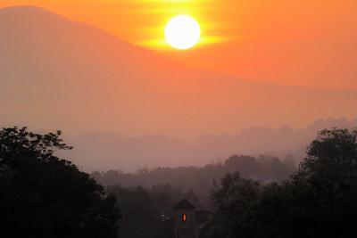 sunrise with light in window-