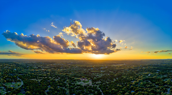 Sunset, Tue, Apr 18, 2017 above Dripping Springs.    The image was created from 30 individual exposures captured from 400 feet up with a DJI Mavic Pro drone.  There were six 5-shot bracketed sets merged to HDR images with Aurora HDR 2017.  The six HDR images where then merged to a panorama with Photoshop.  Final image adjustments in Photoshop and Lightroom.