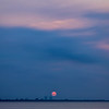 View from the Sanibel Causeway as the sun rises over Fort Myers and San Carlos Bay