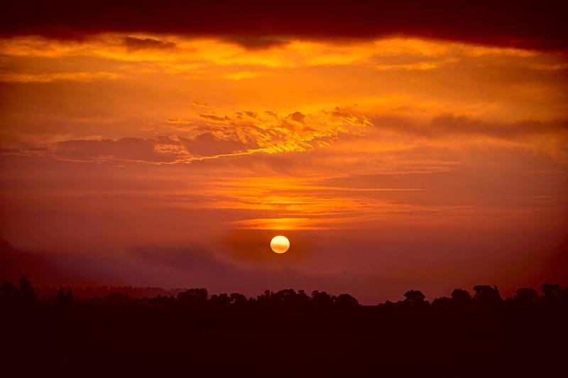 The sun rises through the fog in the Sandhills of Nebraska near Valentine, Nebraska