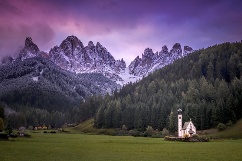 Sunrise over the Church of St. Johann in Ranui, the Dolomites, Italy