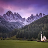 Sunrise over the Church of St. Johann in Ranui, the Dolomites, Italy