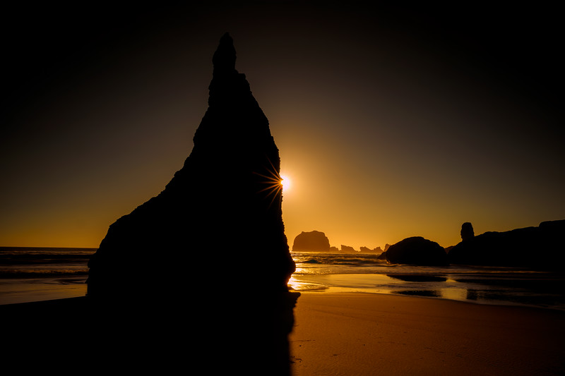 The Wizard's Hat sea stack at sunset on Bandon Beach, Oregon