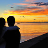 Couple Watching Sunset in Trieste, Italy