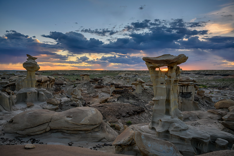 """Clouds and late afternoon light over the """"Alien Throne"""" and other hoodoo sandstone rock formations in the Valley of Dreams in the Ah-Shi-Sle-Pah Wilderness Study Area, New Mexico"""