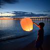 Launching lanterns after sunset at the Venice Fishing Pier, Venice, Florida