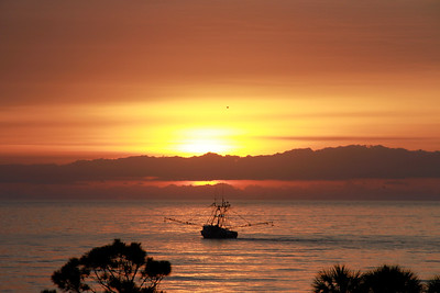 Sunrise with shrimp boat at Hilton Head, S.C.