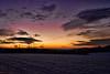 Snowy field sunset