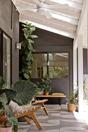 Black porch with wooden white ceiling and skylights.