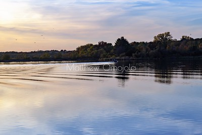 Fall autumn colors  reflections in Ed Zorinsky Lake Omaha NE. Ripples in the water with birds in the air!