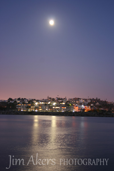 I shot this at Marina del Rey inlet at about 9:30 PM. I used a Canon Rebel Xti; shutter speed was 8 seconds; 40mm; f5.0; iso 100. question for the experts is how do I get moon details so it is not blurred and still get homes as they are? I want this shot only the moon to show the details in other words.  Help