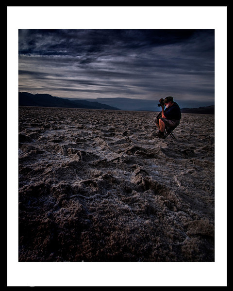 Badwater area of Death Valley.  This shot was taken at sunset.  This area is the lowest below sea level in the United States.  The uneven and curvey surface is dryed salt crystals.  This is not HDR processed.