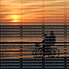 Couple ride side by side enjoying the sunset and getting their exercise on beautiful Fort Myers Beach, Florida, USA
