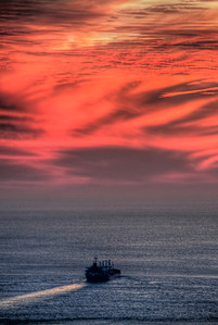 red-clouds-ocean-ship