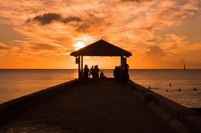 Silhouettes on the pier at Sunset  Waikiki, Hawai'i