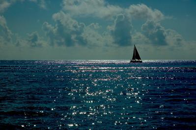 Sailboat at sunset  Waikiki, Hawai'i