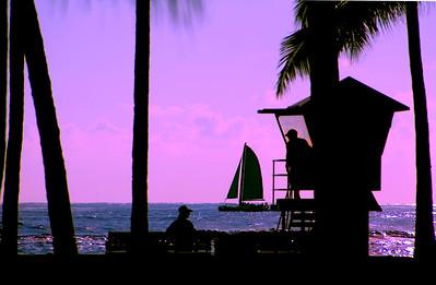 Silhouetted Lifeguard Tower and Sailboat  Waikiki, Hawai'i
