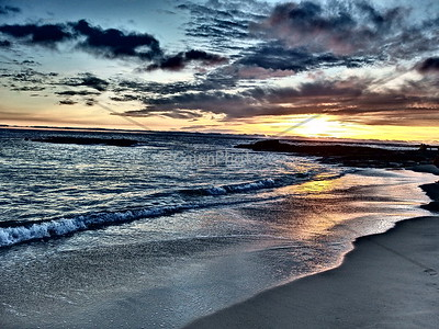This picture was taken with the dramatic filter on my Olympus camera.  I love the way the light reflects on the shore.