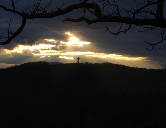 Sun leaking thru to shine on Bald Knob Cross.<br /> Picture name:  Cross Rays