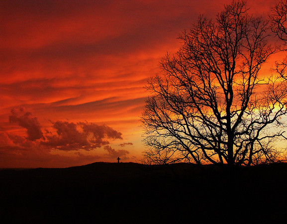 Fiery red sunset behind Bald Knob Cross.<br /> Picture name:  Glory