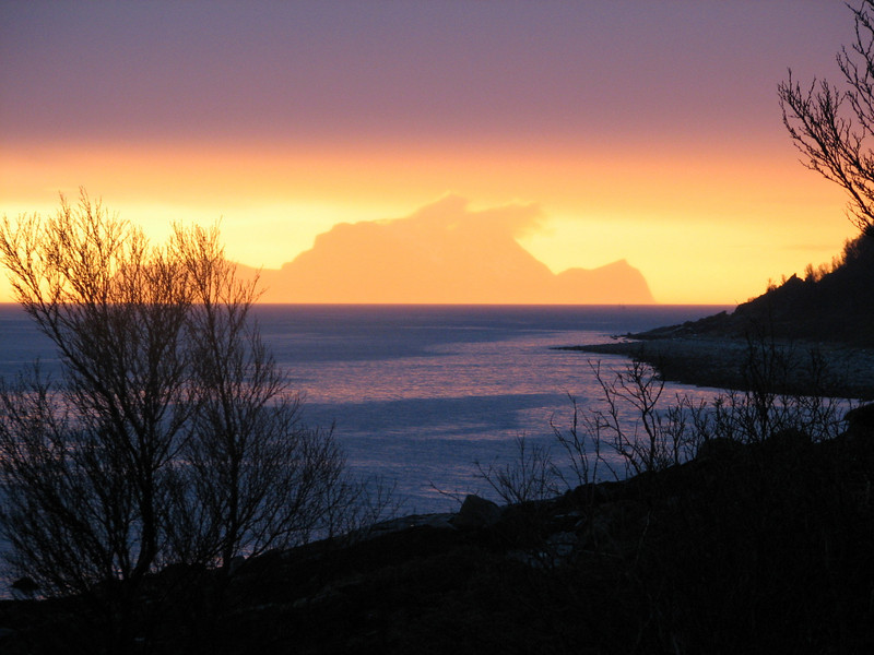 Rain & sun. Midnight middle of May. View towards Nord-Fugløy