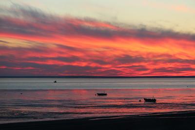 Drift gillnet and setnet skiffs during sunset in Naknek, Alaska