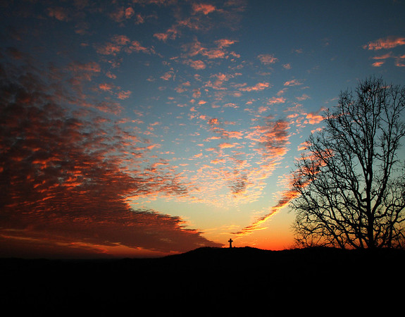 V shaped sunset behind Bald Knob Cross.