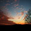 V shaped sunset behind Bald Knob Cross.