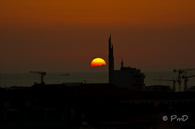 Sunset in Luanda.  The tall structure is a monument to the Angolan president built by the Russians.