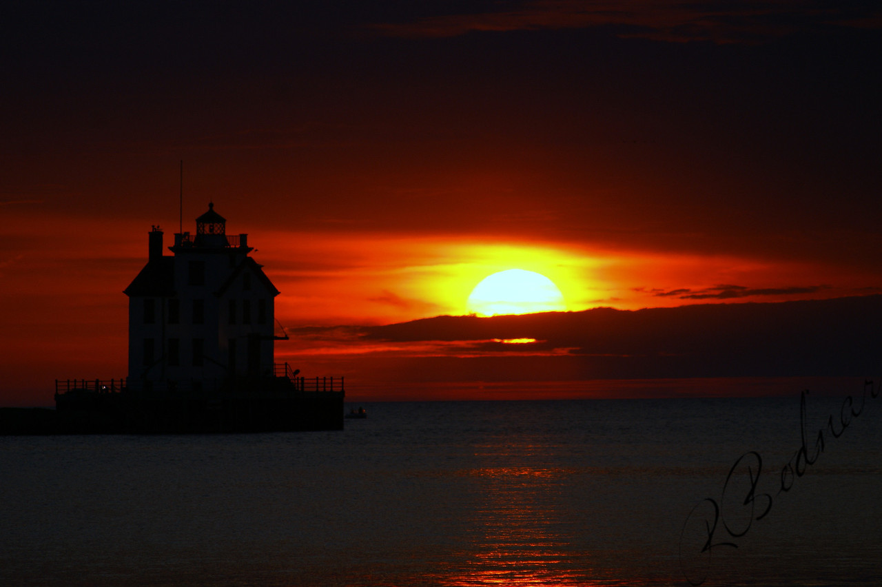 Photo By Robert Bodnar.................................A Silhouette Lihgthouse Sunset