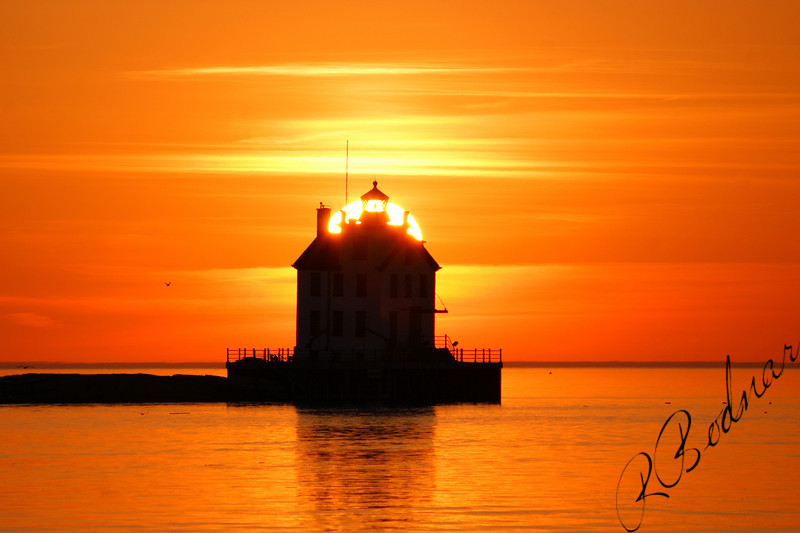 Photo By Robert Bodnar..........................................Behind the lighthouse Sunset