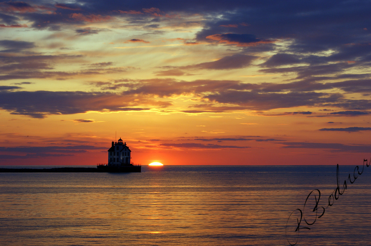 Photo By Robert Bodnar......................................Lighthouse and Sunset