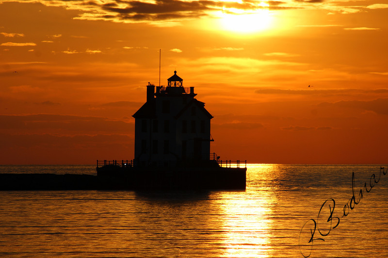 Photo By Robert Bodnar................................Sunset and lighthouse