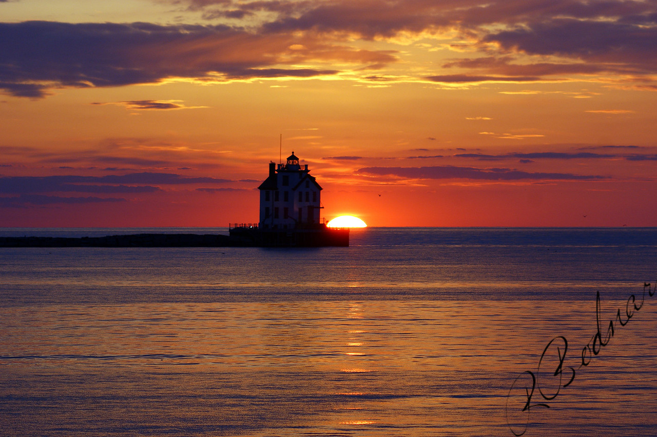 Photo By Robert Bodnar.................................Sunset with Lake, Sky, Lighthouse