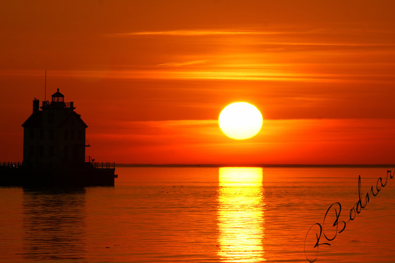 Photo By Robert Bodnar............................Big Sun on Lorain Harbor