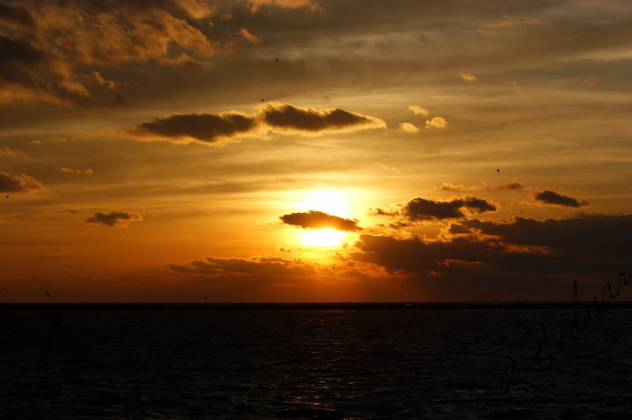 Photo By Robert Bodnar.................A March Sunset on Lake Erie